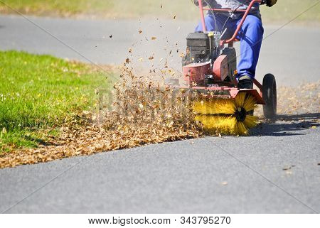 Clean The Street Of The Leaveswith The Brush