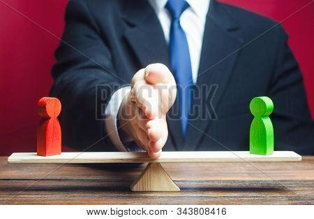 A Man Divides His Opponents On The Scales With His Palm. Mediator Services. Stop Fight, Ceasefire Cl
