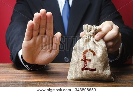 Businessman Refuses To Give Pound Sterling Gbp Money Bag. Refusal To Grant Loan Mortgage, Bad Credit