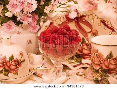 Vintage elegant cups, raspberry and color photos for design