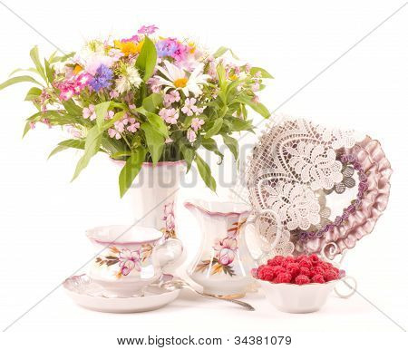 Vintage elegant cups, raspberry and colors on a white background