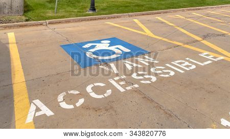 Pano Handicapped Parking Lot With Painted Handicap Symbol And Van Accessible Sign
