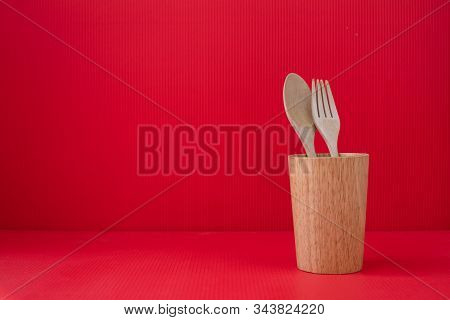 Copy Space On Red Valentines Background With Wooden Spoon And Fork.