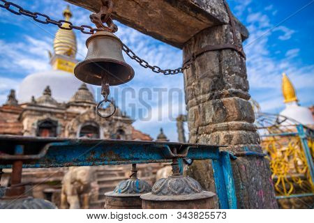 Metal Bell Hanging Infront Of A Sacred Monastery In Kathmandu, Nepal. Buddhist Gompa. Buddhism.