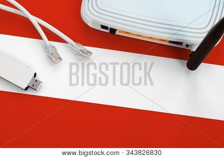 Austria Flag Depicted On Table With Internet Rj45 Cable, Wireless Usb Wifi Adapter And Router. Inter