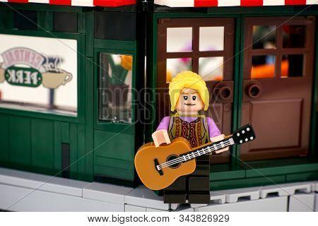Tambov, Russian Federation - January 03, 2020 Lego Phoebe Buffay Minifigure With Guitar Standing Nea