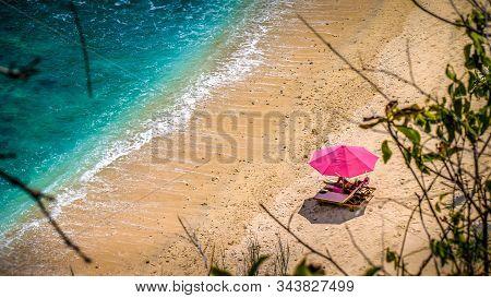 Lila Sunbed on Beautiful White Sand. Clear Blue Ocean, Atuh Beach, Nusa Penida, Bali, Indonesia poster
