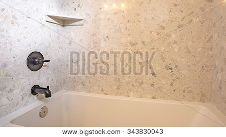 Pano Close Up Of Square Built In Bathtub With Black Faucet Inside A Home Bathroom