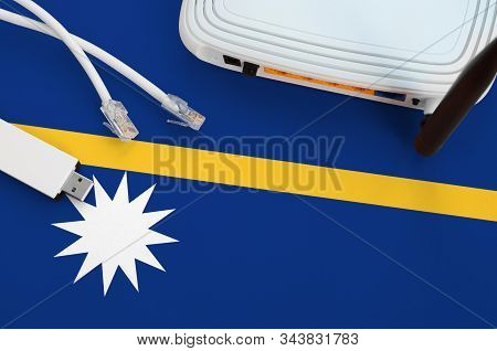 Nauru Flag Depicted On Table With Internet Rj45 Cable, Wireless Usb Wifi Adapter And Router. Interne