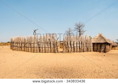 Mafwe Kraal, A Traditional Homestead Of Natives In Namibia With Wooden Fence And Huts