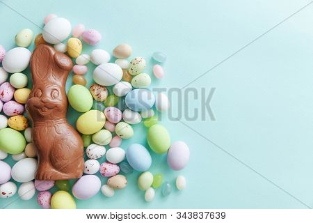 Happy Easter Concept. Preparation For Holiday. Easter Candy Chocolate Eggs Bunny And Jellybean Sweet