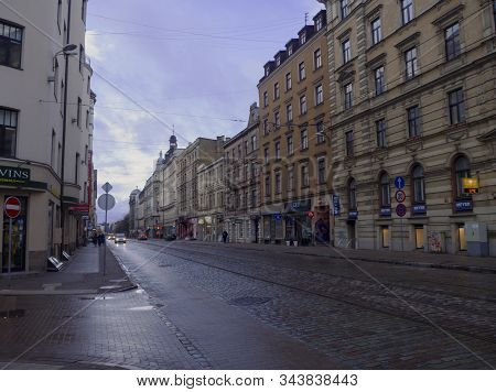 Half Empty Streets Of Old Riga After Rain. View Of The Carriageway And Cobblestone Pavement. 2020-01