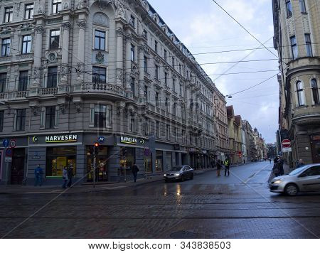 Streets Of Old Riga After Rain. View Of The Carriageway And Cobblestone Pavement. 2020-01-04. Riga,