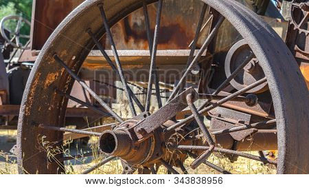 Pano Close Up Of The Rusty Wheels Of An Old Vintage Tractor On A Farm On A Sunny Day