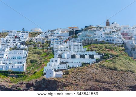 Santorini, Greece - August 10 2019; View Across To Characteristic White Architecture From Skaros Roc