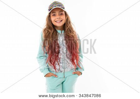 Teenager Girl With Long Haiir In Sport Suit Smiles Isolated On White Background.