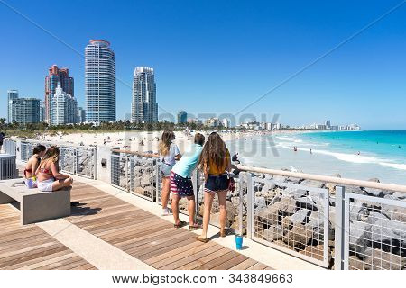 Miami,usa-march 15,2018:people Admire Miami Beach From The South Point Park Pier In Miami During A S