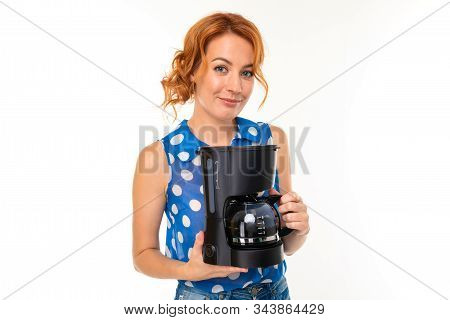 Charming Girl With A Coffee Maker On A White Background.