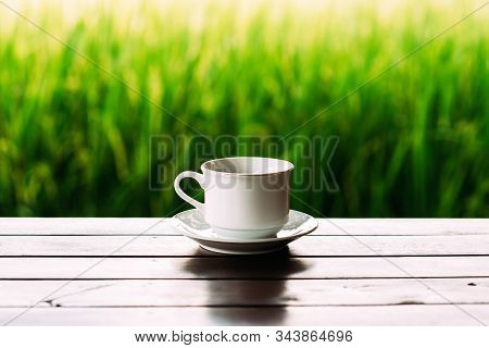 White Tea Cup On A Beautiful Background. White Coffee Cup On The Background Of Rice Terraces In Bali