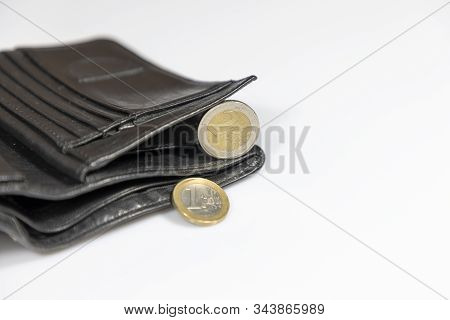 Wallet Filled With Money, On The White Reflective Tabletop. Wallet On A White Background With A Prot