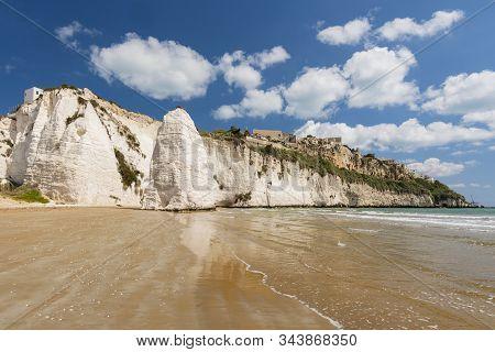 Limestone Rock Monolith And Cliffs By The Beach, Vieste, Gargano, Apulia, Italy.