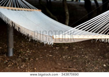 A White Cloth Hammock Fastened Between The Struts. Selective Focus.