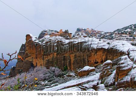 Picturesque Winter Landscape Of Mountains And Trees Covered With Snow In The Forest. Ancient Buildin