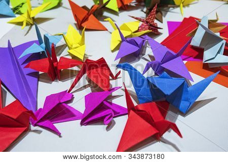 Color Paper Cranes Of Origami From Paper.multi-colored Origami In The Form Of Cranes On The Table. O