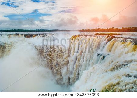 Iguazu Falls On The Border Of Argentina And Brazil, View Of Devil's Throat Waterfall, The Largest In