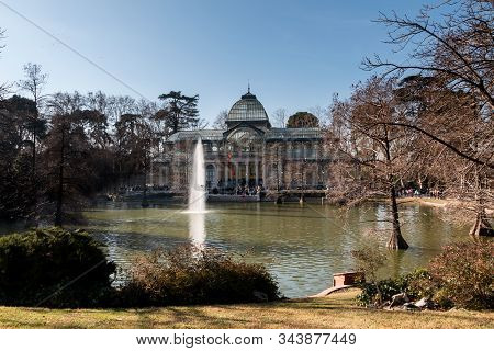 Madrid, Spain. Jan 2020: Palacio De Cristal Building In Front Of The Lake And Fountain In The Parque