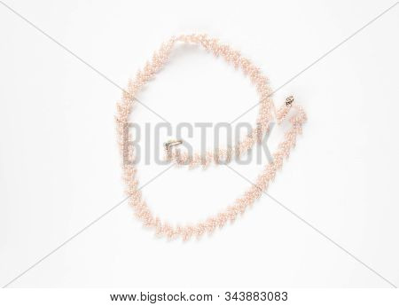 Pink Seed Bead Necklace Isolated On A Light Background.  Beading Craft Is A Woven Beaded Fashion Acc