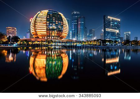 Hangzhou, China - November 09, 2019: Night view of illuminated Qianjiang New City. It is currently one of two central business districts and the financial district of Hangzhou city.
