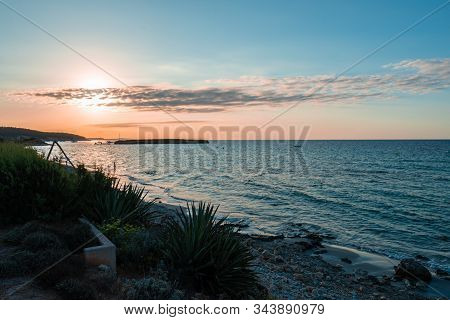 Sunset Time In Santo Tomas Beach On The Island Of Menorca.