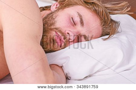 Man Handsome Guy Lay In Bed. Get Adequate And Consistent Amount Of Sleep Every Night. Expert Tips On
