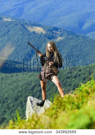 Hunting Season. She Is Warrior. Warrior Mountains Landscape Background. Sexy Warrior. Woman Attracti