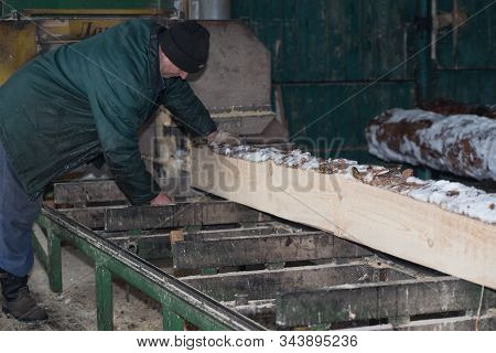 Woodworking In The Workshop In The Winter.