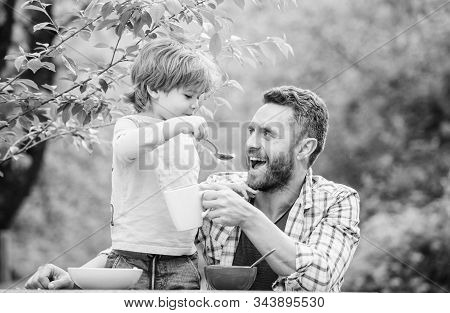Feeding Baby. Menu For Children. Family Enjoy Homemade Meal. Father Son Eat Food And Have Fun. Food