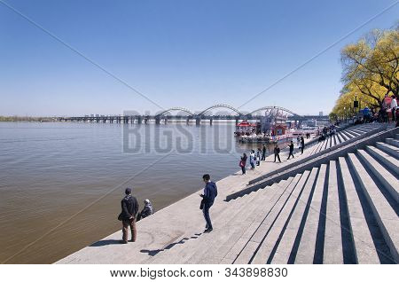 Harbin, China.  May 4, 2016.  Chinese People On The Steps Of The Harbin Stalin Park On The Banks Of