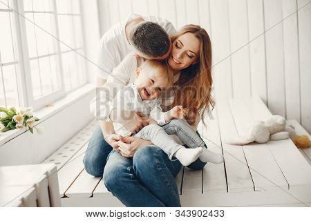 Cute And Big Family Sitting At Home
