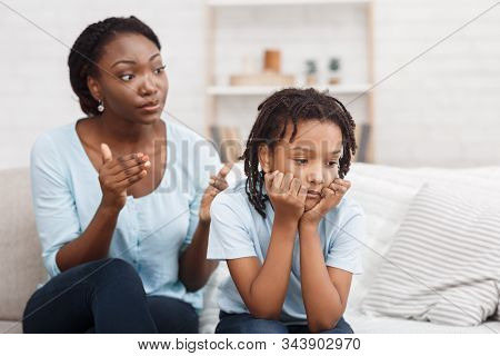 Family Conflict. Quarrel Between Black Mother And Daughter At Home, Sulky Child Ignoring Her Mom, Co