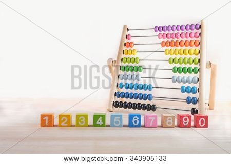 Bright Colored Wooden Bricks With Numbers And Abacus Toy With Copy Space, Numeral Cubes With Numbers