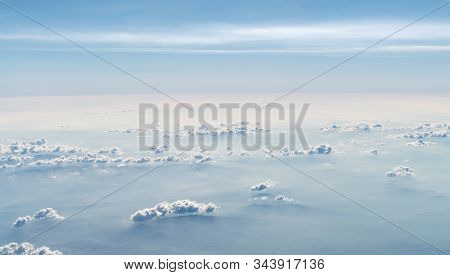 Beautiful Cloudscape. Aerial View Of Clouds And Sky. Bird Eye View From Airplane Window. Clouds Pano