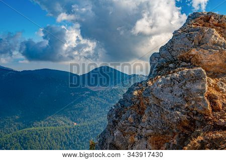 Beautiful Mountains Aerial Landscape View. Mountain Peak Of Rocks Covered By Clouds And Fog. Mountai