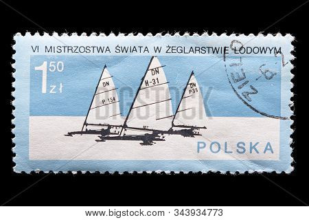 Novosibirsk, Russia - January 07, 2020: Stamp Printed In Poland Shows How Three Small Yachts With Sa
