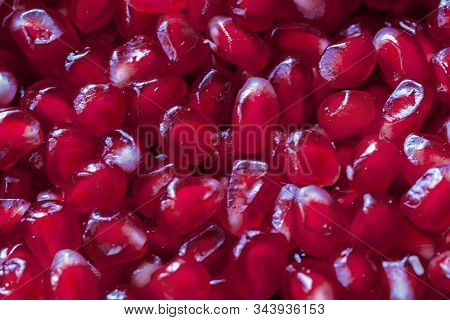 Background Of Red Ripe Juicy Pomegranate Grains