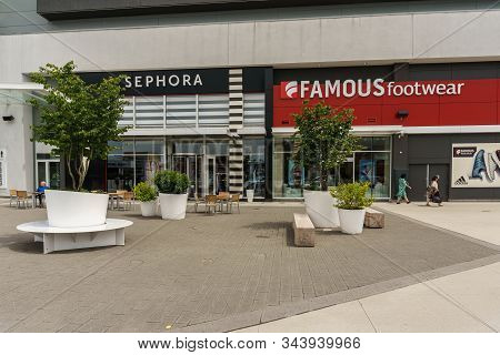 Abbotsford, Canada - June 9, 2019: Shopping Mall In City Center With Shops Banks And Parking Lots.