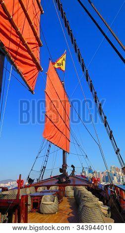 Hong Kong, East Asia - November 22, 2019: Red Sail Of The Aqualuna Touring Junk Boat In Victoria Har