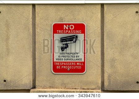 Building Exterior With Close Up View Of No Trespassing Sign On Concrete Wall