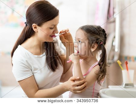 Mother Teaches Her Child Daughter Accurately Brushing Teeth