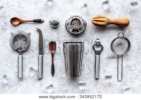 Bartender Equipment Set With Shaker And Stainer And Ice Cubes On Grey Background Top-down Pattern